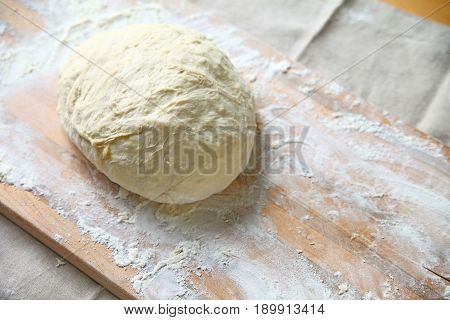 Yeast dough on a floured cutting board after kneading