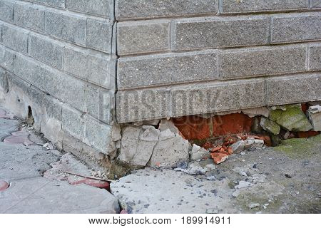 Foundation Repair - Warning Signs. House foundation repair. Foundation Repair. Broken Foundation House Brick Wall.