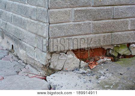 Foundation Repair - Warning Signs. House foundation repair. Foundation Repair. Broken Foundation House Brick Wall.
