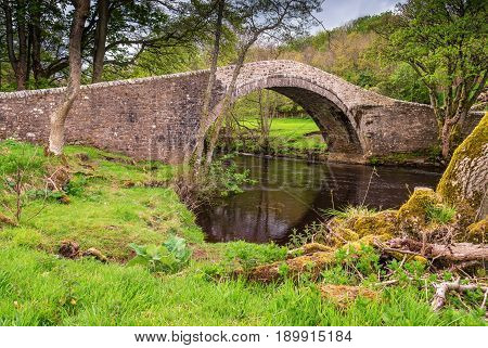 Ivelet Bridge - The picturesque hump-backed bridge at Ivelet crosses the River Swale approximately a mile and half west of Gunnerside in Swaledale
