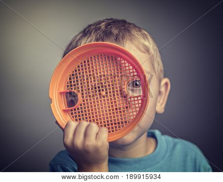 Preventing Child Abuse concept portrait of kid hide himself with toy