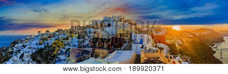 Amazing view with white houses in Oia village on Santorini island in Greece at sunrise.