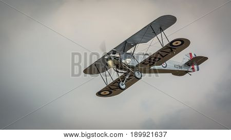 Biggleswade UK - 7th May 2017: Vintage 1928 Hawker Tomtit biplane in flight