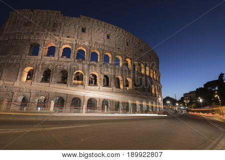 Light trails at Colosseum in Rome at dusk Italy