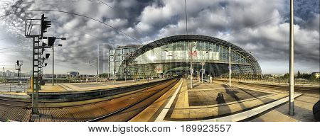 BERLIN, SEP, 27 2008: Panoramic view of modern Berlin architecture of rail way station platform rail tracks. Berlin architecture railway station biggest in Europe Railway station Hauptbahnhof panorama