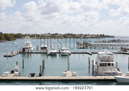 Jupiter FL USA - March 30 2017: Loxahatchee River boats docked in a marina on a mostly sunny day. Many boats parked in docks on the Loxahatchee River.
