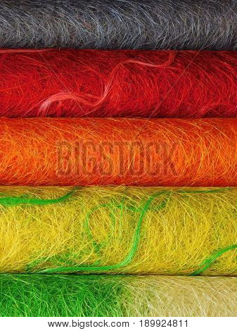 Multicoloured rolls of decorative sisal for creative works