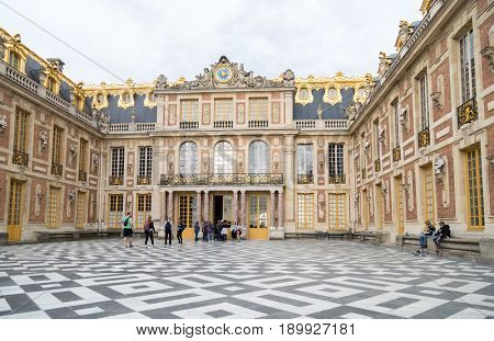 Paris, France, March 28 2017: Head main entrance with the people tourists in the Versailles Palace. Versailles
