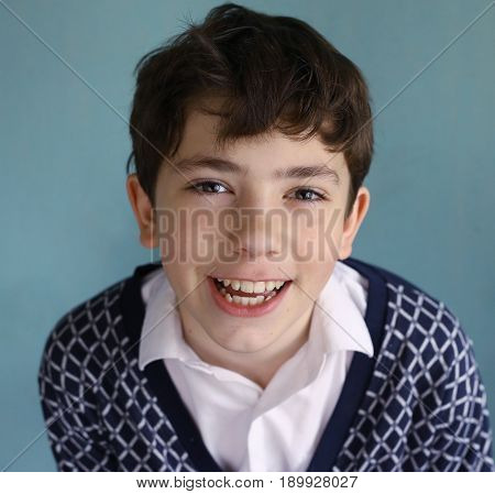 teen smiling boy close up portrait with strong white healthy teeth