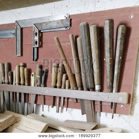 Old Hanging Chisels At The Wall