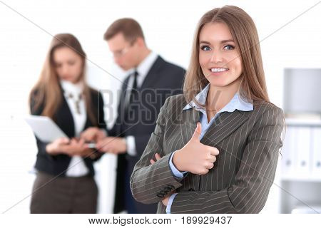 Face of beautiful cheerful smiling business woman on the background of business people Successful business concept
