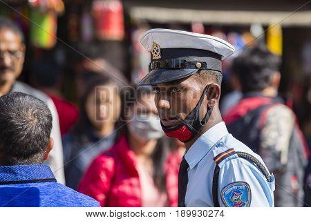 KATHMANDU NEPAL - OCTOBER 25 2016 : Nepali police maintain order on the streets of Kathmandu