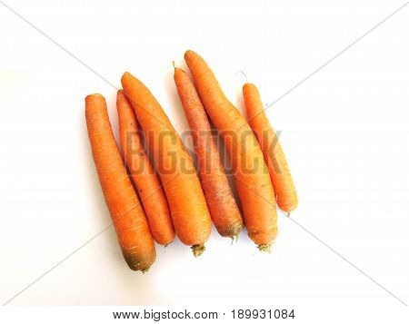 Carrots eating on white background in kitchen