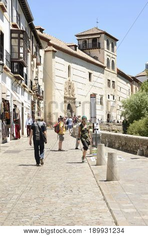 GRANADA, SPAIN - MAY 20, 2017: People strolling by the path along the river named