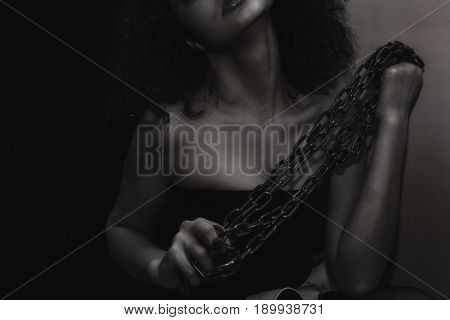 Portrait of a young woman with a metal chain closeup