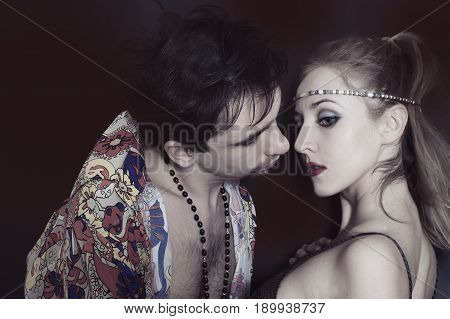 Studio portrait of young lovers on a black background