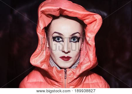 Young woman with make-up in Gothic style dressed in red kayushon
