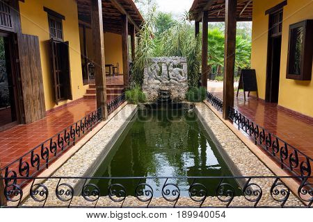 Small pool in a colonial courtyard near Uxmal Mexico