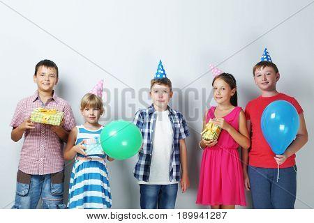 Portrait of happy children on grey background
