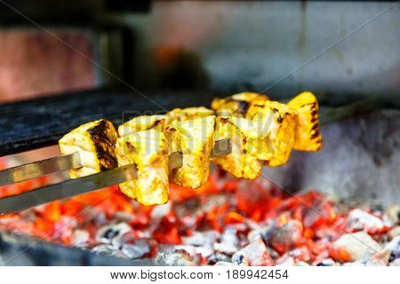 Skewers Of Fish (salmon And Sturgeon) Roasting On The Grill.