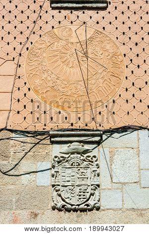 Old wall sundial on a facade in Segovia Spain