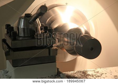 The CNC lathe machine (Turning machine) when cutting with a chisel .The hi-technology machining concept.
