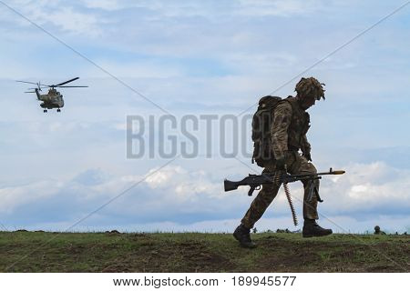 British army personnel take part in the NATO 'Wind Spring 15' military exercise at Smardan military shooting range on April 22, 2015.