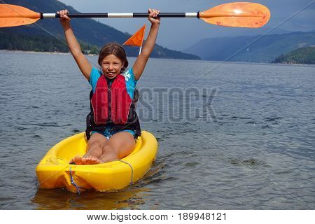 Picture of a girl in a kayak in Shuswap lake, British Columbia, Canada.
