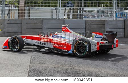 PARIS - 20 May 2017: The Formula E car of the Swedish racing driver F. Rosenqvist of Mahindra Racing Team racing the Paris ePrix on the Invalides Circuit.This car is only electric-powered.