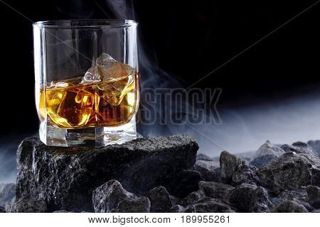 Glass Of Whiskey And Ice.creative Photo Glass Of Whiskey On Stone With Fog.copy Space.advertising Sh