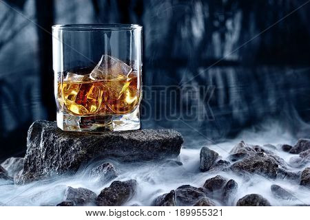 Glass Of Whiskey And Ice.creative Photo Glass Of Whiskey On Stone With Fog And Cold Background.copy