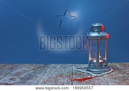 lightened Lantern with star and Rosary on blue background