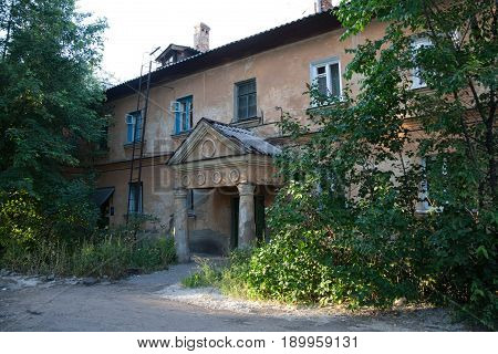 Old Soviet two-storied house with portico built by German prisoners after World War II in the late 40's and early 50's