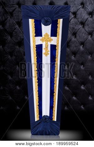 closed coffin covered with blue and white cloth decorated with Church gold cross isolated on gray luxury background. Ritual objects for burial. Surrender body dust of the earth. Vertical position.