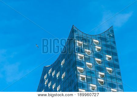 Hamburg, Germany - May 28, 2017: Top shape of Elbphilharmonie with white windows and some white clouds in sky, Hamburg, Germany.
