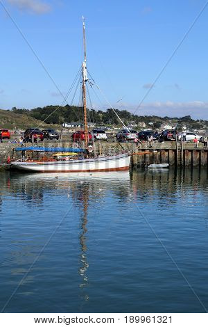 Padstow, Cornwall, Uk - April 6Th 2017: Old Fashioned Vintage Sailing Boat Moored On The Harbor Wall