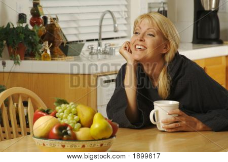 Beautiful Young Successful Woman, Enjoying A Cup Of Coffee In Her Home.