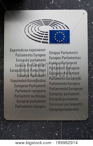 Brussels Belgium -February 25 2017: Logo of the European Parliament at the facade of European Parliament building in Leopold Square.