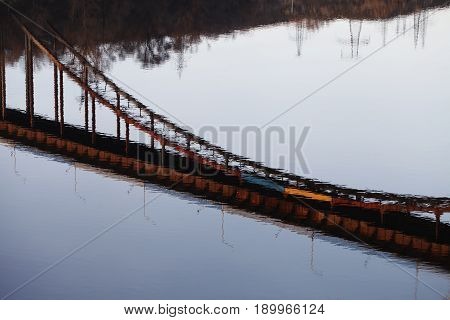 a reflection of the bridge in  water , bending facilities