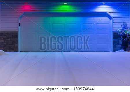 Red Green and Blue Light Over Snowy Driveway - winter