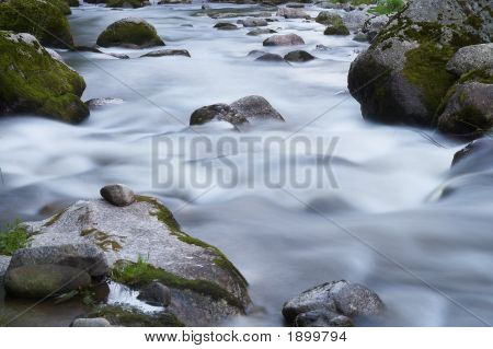 Small Creek With A Lot Of Stones And Rocks