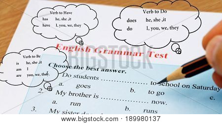 blue English grammar test on table with drawing