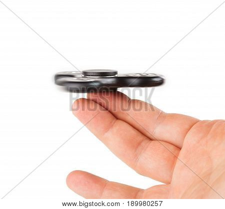 Palying With A Black Fidget Spinner