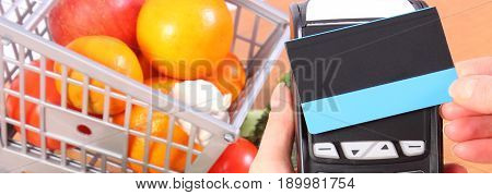 Payment Terminal With Contactless Credit Card And Fruits And Vegetables, Concept Of Cashless Paying