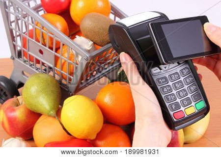 Payment Terminal And Mobile Phone With Nfc Technology, Fruits And Vegetables, Concept Of Cashless Pa