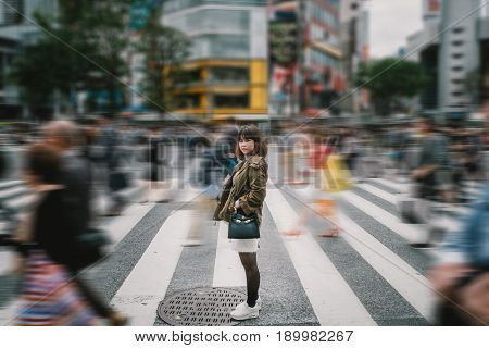 Portrait girl crossing busy city street/ Girl Crossing Street/ Girl crossing street in Tokyo Japan