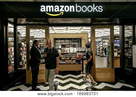 New York June 1 2017: People are walking in and out of newly opened Amazon Books store in Time Warner Center.
