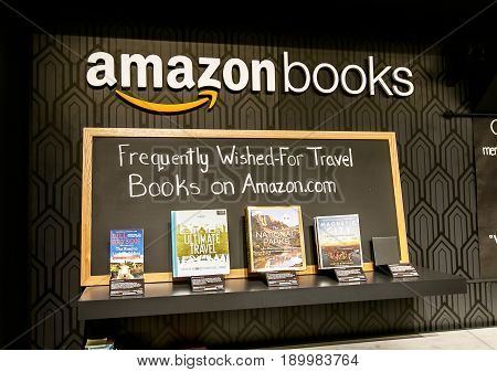 New York June 1 2017: A few books are put on display at the wall behind the checkout counter in a newly opened Amazon Books store in Time Warner Center.