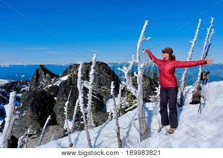 Woman meditating on mountain top. Inner peace. Yoga in Central Cascade Mountains. Icicle Ridge trail near Leavenworth and Seattle. Washington. United States.