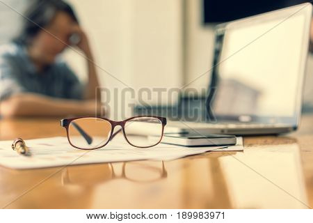 Depressed businesswoman in office soft focus vintage tone